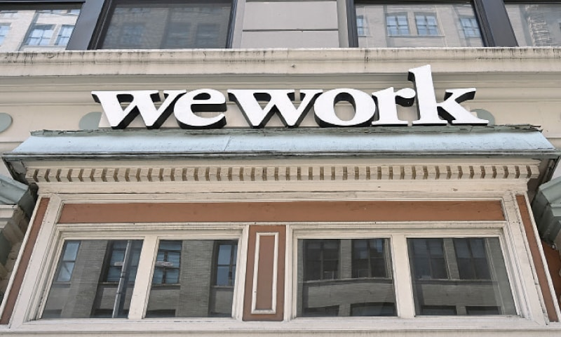 A WeWork office is seen in New York City on July 19, 2019. WeWork has slashed by more than half its valuation target after setting an ambitious goal for the fast-growing office-sharing startup, sources familiar with the company said last week. WeWork parent We company is eyeing a target market value of around $20 billion after hearing doubts about its prospects from potential investors over a $47 billion valuation, the sources said. The startup launched in 2010 touts itself as revolutionising commercial real estate by offering shared, flexible work space arrangements, and has operations in 111