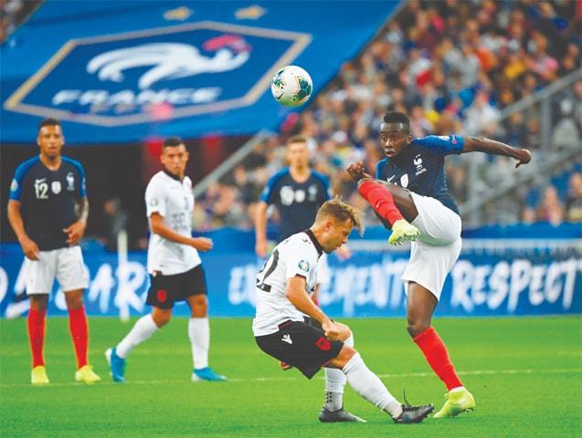 PARIS: Albania's Amir Abrashi vies for the ball with France's Blaise Matuidi (R) during their Euro 2020 qualifier at the Stade de France.—AFP