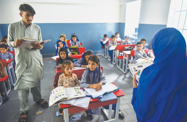 Students of class two learning their lessons for the day.—Fahim Siddiqi / White Star