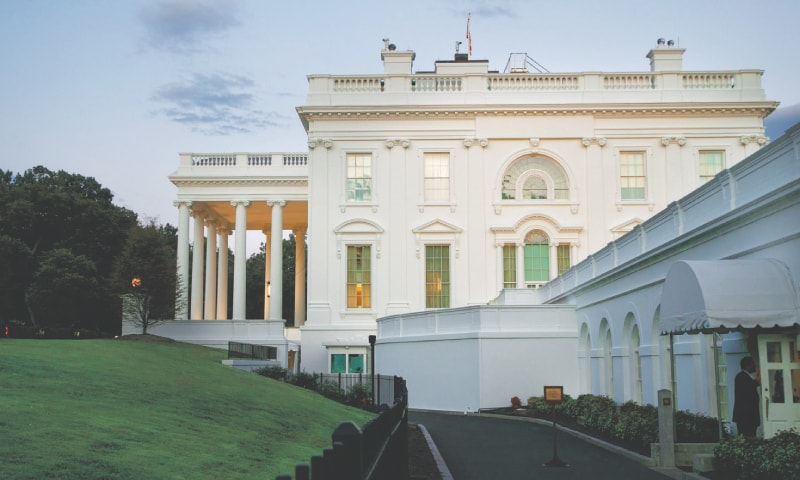 Washington: A man enters the press area of the White House at dusk  on Saturday.—AP