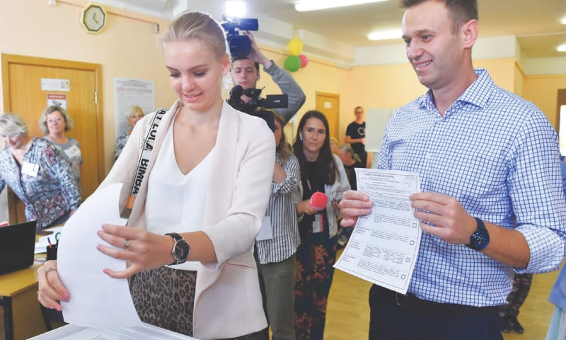 Moscow: Russian opposition leader Alexei Navalny (right) looks on as his daughter Daria casts her vote at a polling station during the Moscow city election on Sunday.—AFP