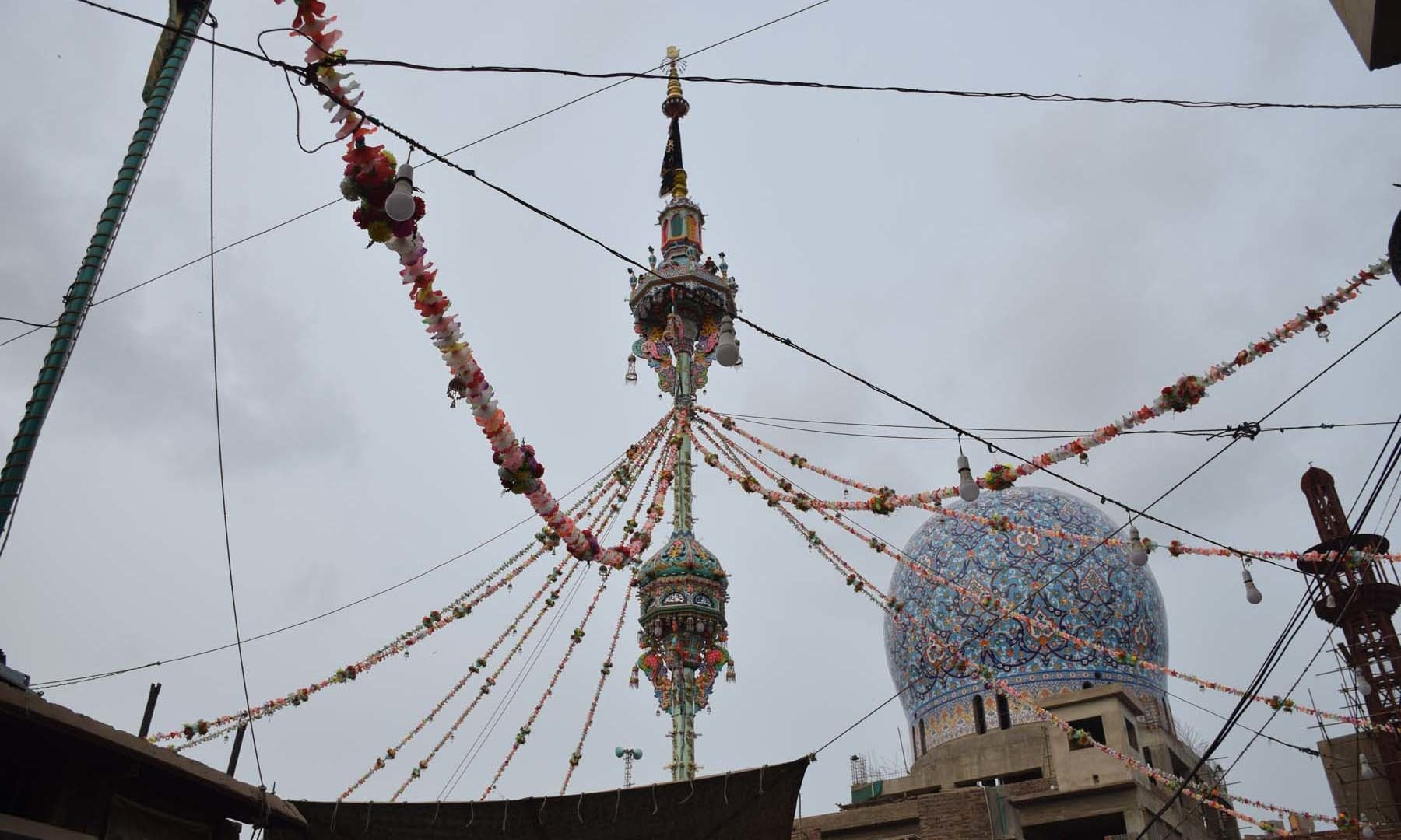 A view of around 90 feet high alam at Qadam Gah Maula Ali. Qadam Gah Maula Ali is a place where the *musallah* (prayer mat of stone with imprints of Hazrat Ali's (RA) forehead, hands, knees and feet in the position of prostration) is kept. It was said to be gifted to Talpur dynasty ruler Ghulam Ali by Iranian king Shah Kachaar in 1803, according to Zawar Sattar Dars. — Umair Ali