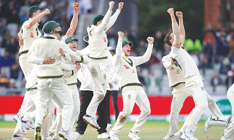 AUSTRALIAN players celebrate the dismissal of England's Craig Overton to win the fourth Test and retain the Ashes at Old Trafford.—Reuters
