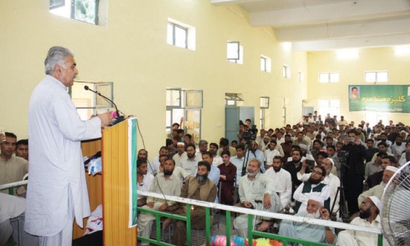 Poet Prof Abaseen Yousafzai recites his verses in Bisham on Monday. — Dawn