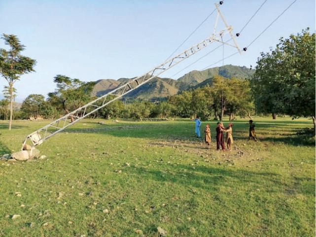A broken power pylon in Charmang valley of Bajaur. — Dawn