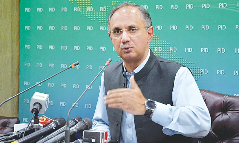 MINISTER for Power Omar Ayub Khan addressing a press conference on Monday.—APP