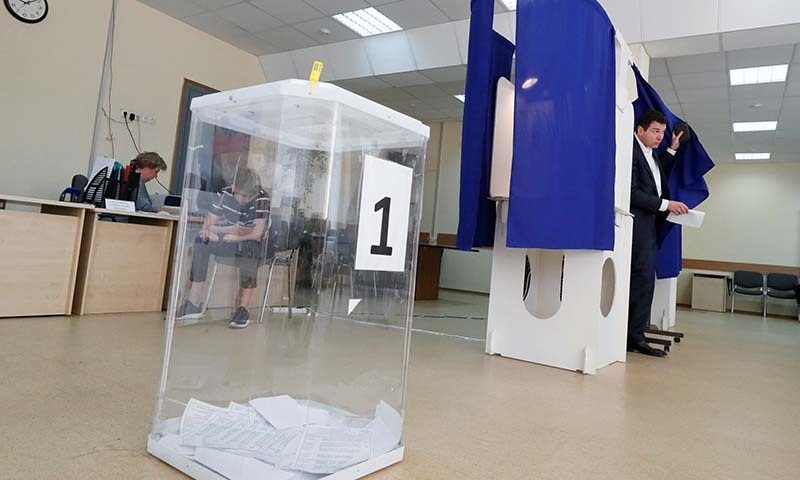 A man walks out of a voting booth at a polling station during the Moscow city parliament election in Moscow, Russia on September 8. — Reuters