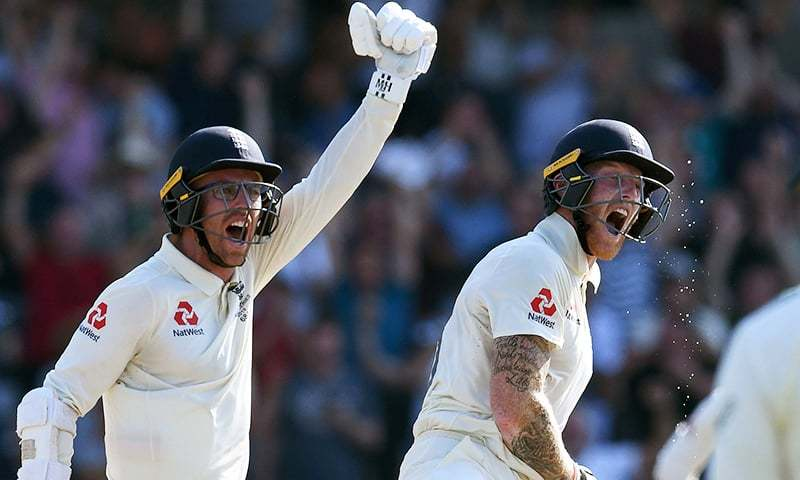 In this file photo, England's Ben Stokes (R) and England's Jack Leach react after England won the third Ashes cricket Test match between England and Australia at Headingley in Leeds, northern England, on August 25. — AFP