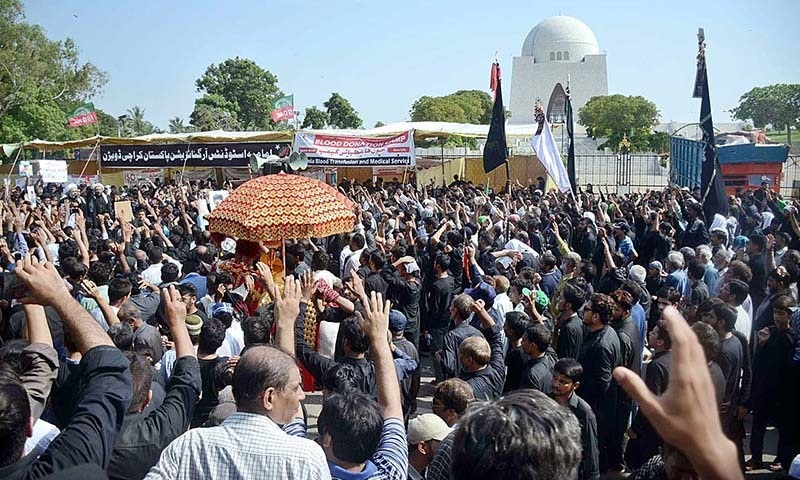 A large number of mourners attending procession on Monday at New MA Jinnah Road in Karachi. — APP