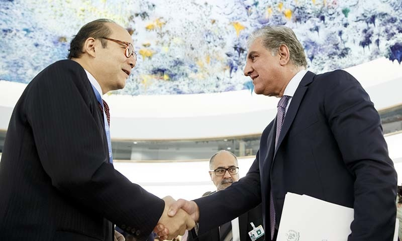 FM Qureshi shakes hands with China's Ambassador Chen Xu after delivering his statement during the 42nd session of the Human Rights Council at the European headquarters of the United Nations in Geneva on Tuesday. — AP