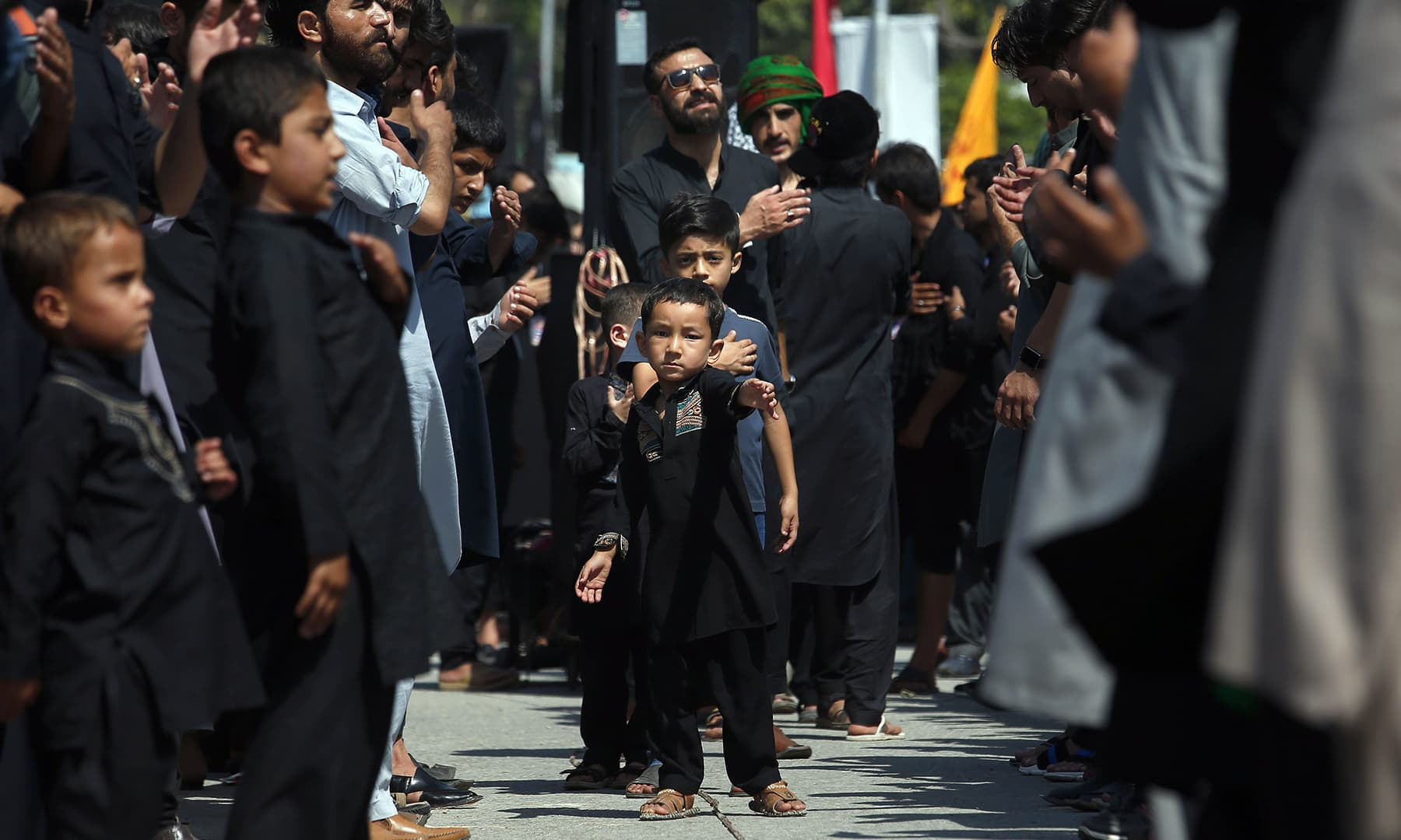 Shia Muslim boys beat their chest with others during a Muharram procession, in Islamabad, Monday. — AP
