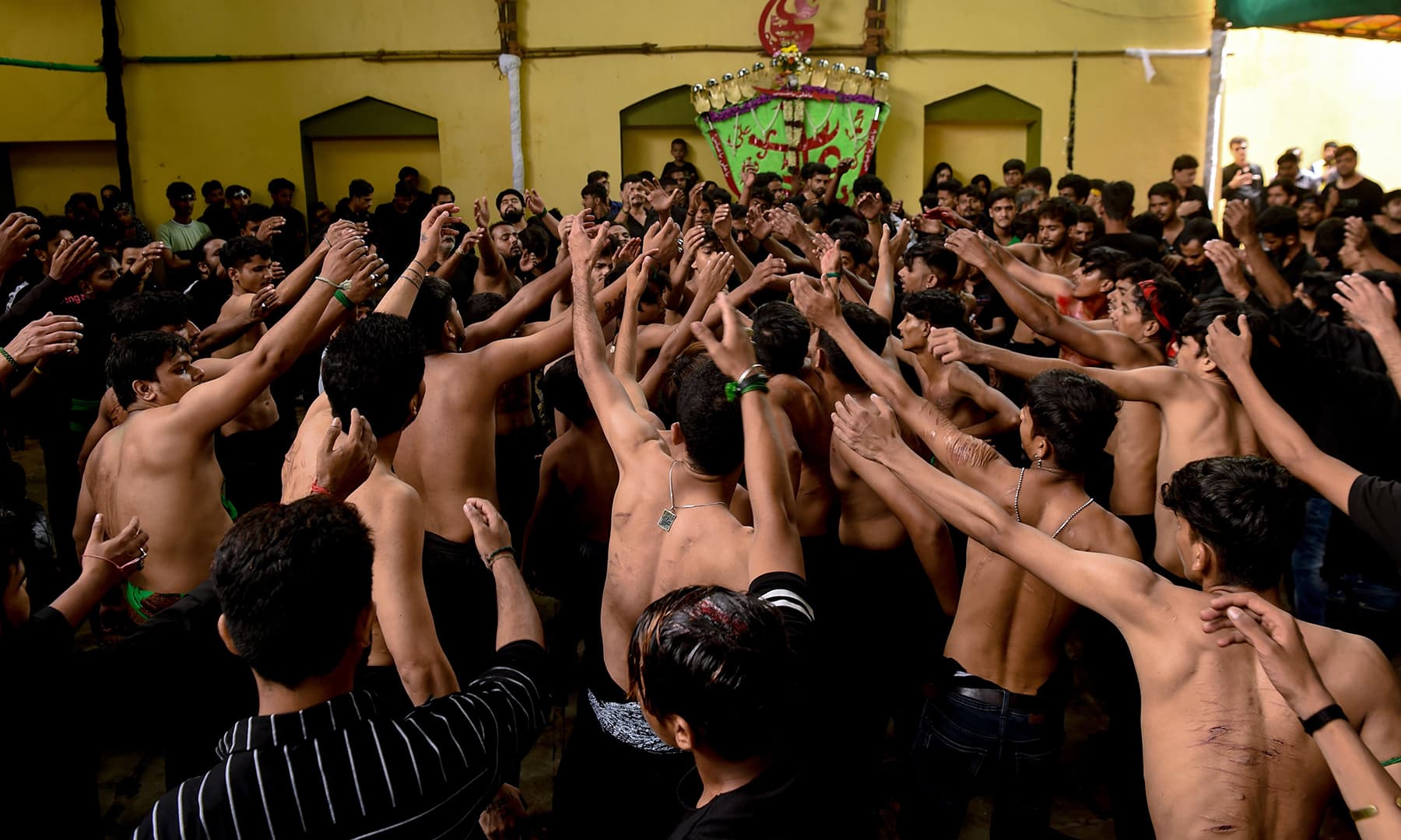 Mourners beat their chest during a procession on the tenth day of Muharram which marks the day of Ashura, in Mumbai. — AFP