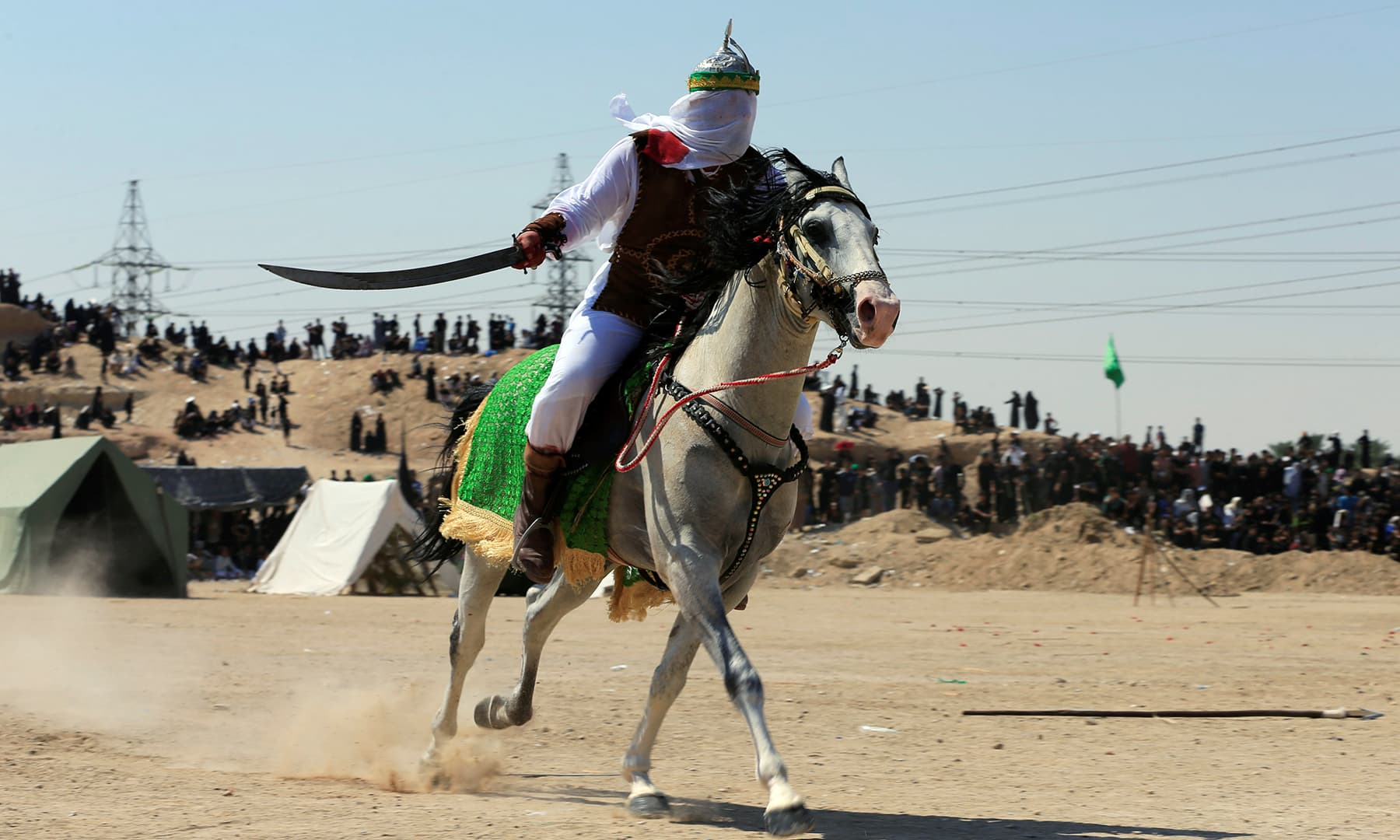 A local actor dressed as ancient warrior re-enacts a scene from the 7th century battle of Karbala during a ceremony marking Ashura in the holy city of Najaf, Iraq, September 10. — Reuters