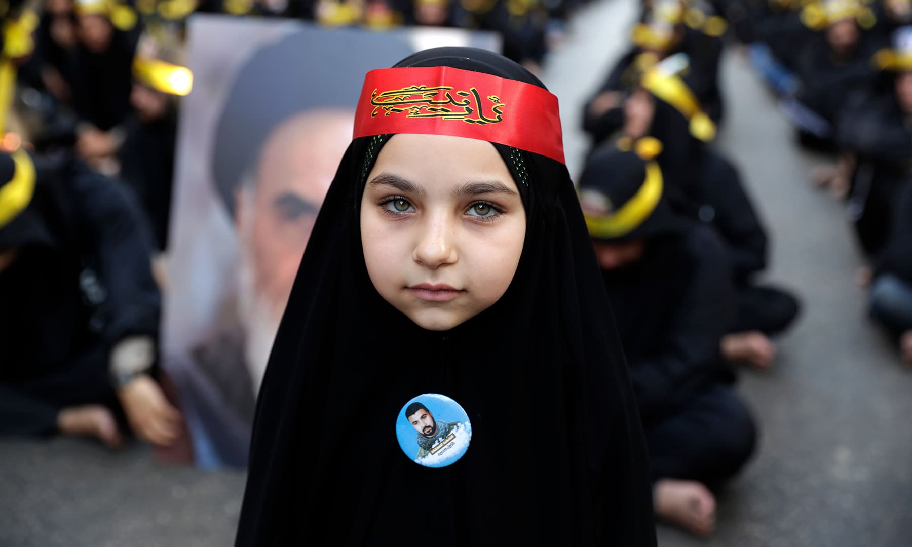 A black-clad young girl is pictured as she takes part with supporters of the Lebanese Hezbollah movement in a mourning procession on the tenth day of Muharram in a suburb of the capital Beirut, on September 10. — AFP