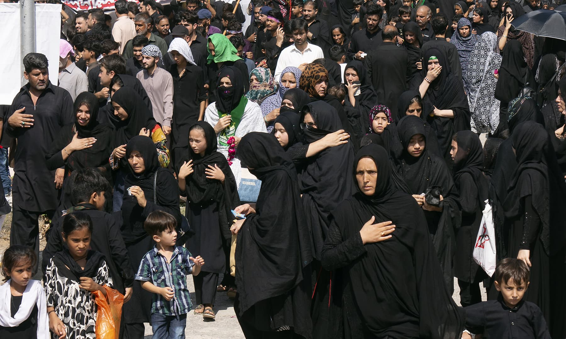Shia Muslims attend a Muharram procession in Islamabad on Monday. — AP