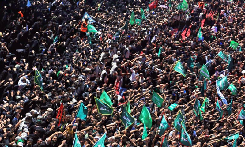 Hundreds of thousands of pilgrims from around the world swarmed Karbala on Tuesday. — AFP