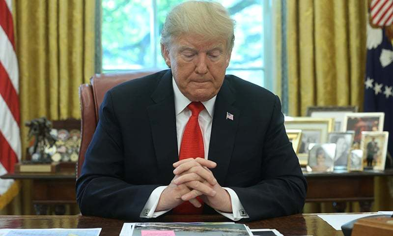 US President Donald Trump views tracking forecast maps as he receives a status report on Hurricane Dorian in the Oval Office of the White House in Washington, US, September 4. — Reuters