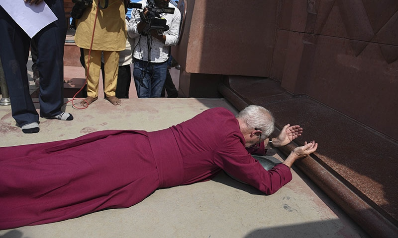 The Archbishop of Canterbury Rev Justin Welby, prostrates as he pays respect at the Jallianwala Bagh memorial in Amritsar, India on Tuesday. — AP