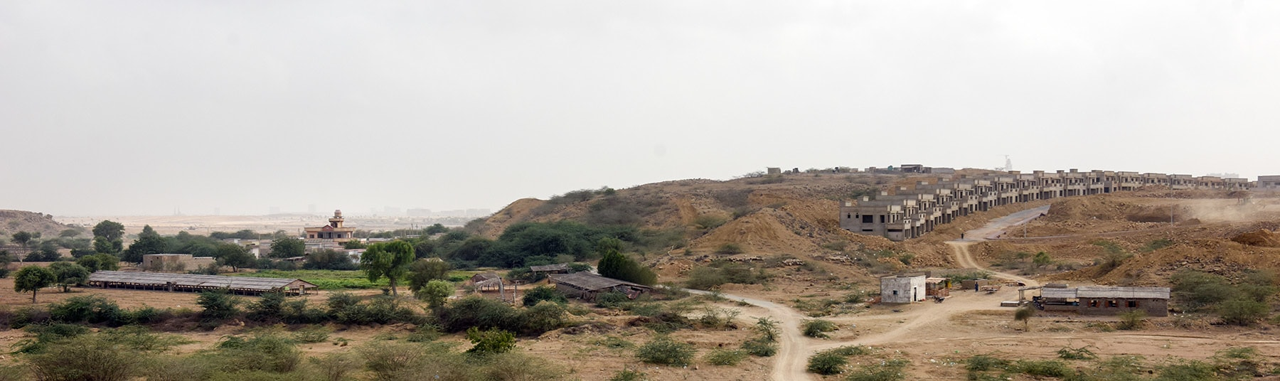 A small farm on the left in the path of the advancing Bahria Town. – White Star