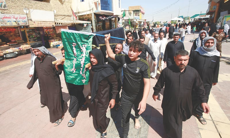 Najaf: Relatives carry a victim's body for funeral.—Reuters