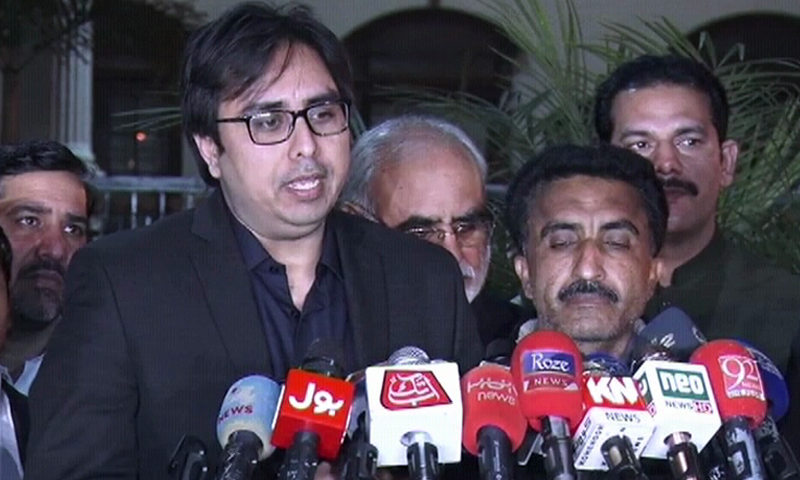 Dr Shahbaz Gill speaks to the press. — DawnNewsTV