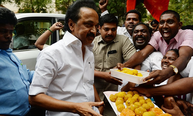 In this file photo taken on December 21, 2017, Indian Dravida Munnettra Kazhagam (DMK) party working President MK Stalin distributes sweets to party supporters at the home of party leader Karunanidhi in Chennai. — AFP
