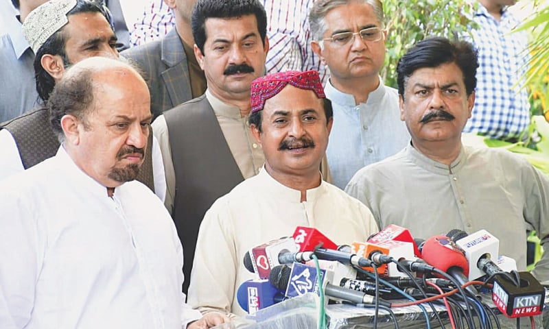 PTI leaders address a press conference at Sindh Assembly building on Friday. — PPI