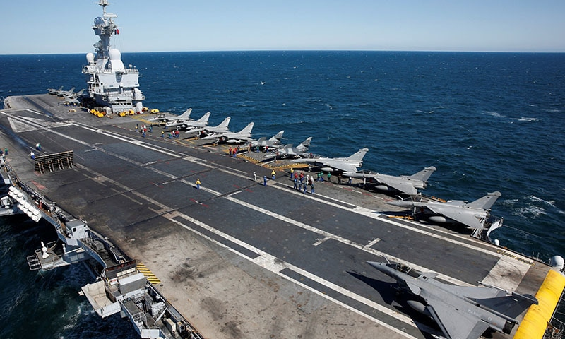Rafale and Super Etendards fighter jets are parked prior to a mission aboard France's Charles de Gaulle aircraft carrier sailing in the Gulf on January 28, 2016. — Reuters