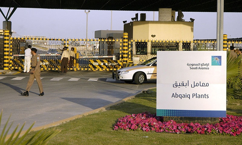 In this file photo taken on February 25, 2006 Saudi security guard the entrance of the oil processing plant of the Saudi state oil giant Aramco in Abqaiq in the oil-rich Eastern Province. — AFP