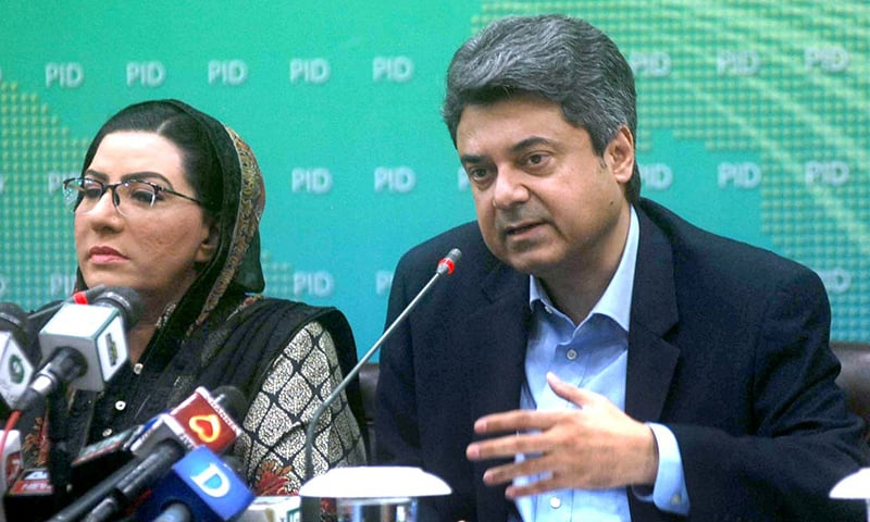 Federal Minister for Law and Justice Barrister Dr Muhammad Farogh Naseem together with Special Assistant to PM for Information and Broadcasting Dr Firdous Ashiq Awan addresses a joint press conference at PID in Islamabad on Saturday. — APP