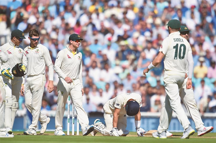 LONDON: England opener Joe Denly doubles over after being hit by a ball in the midriff during play on the third day of the fifth Test against Australia at The Oval.—AFP