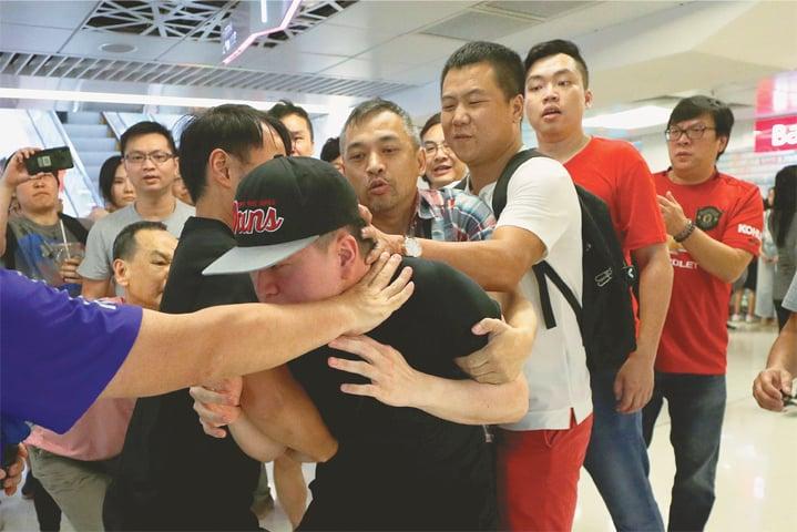 Mall brawls and street fights as Hong Kong polarisation deepens