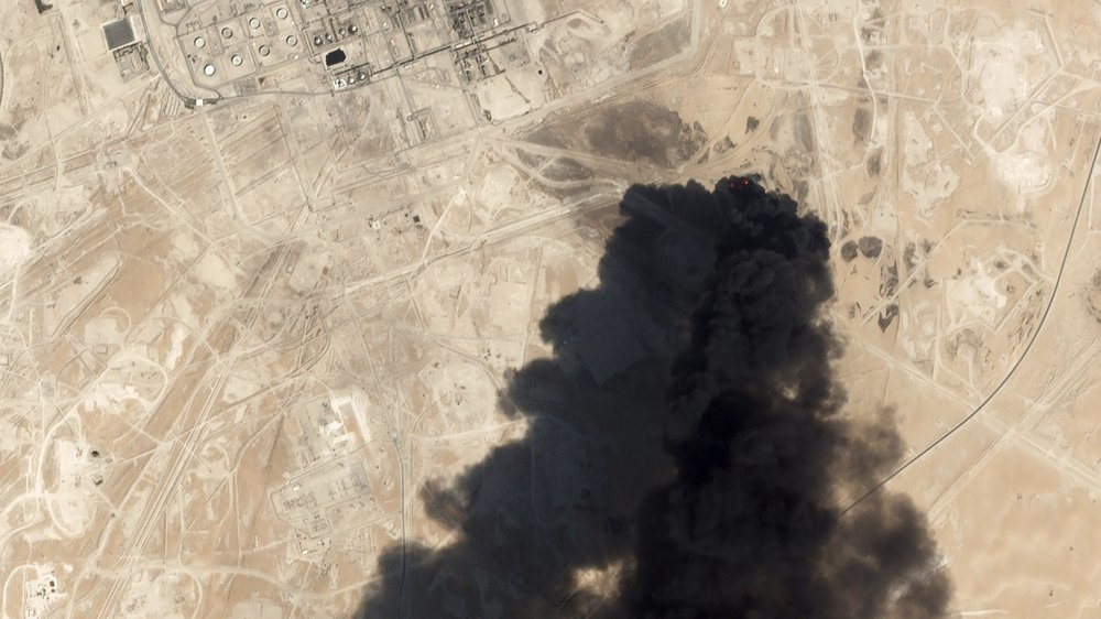 This Sept 14 satellite image from Planet Labs Inc. shows thick black smoke rising from Saudi Aramco's Abqaiq oil processing facility in Buqyaq, Saudi Arabia. — AP
