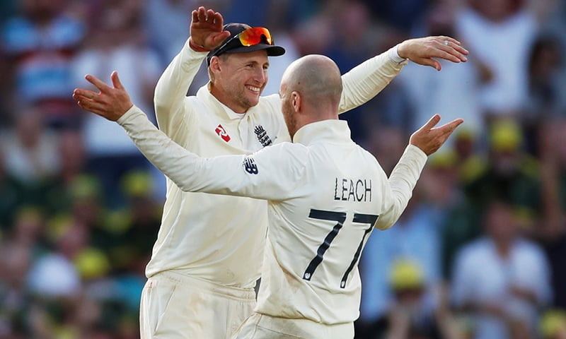 England's Joe Root and Jack Leach celebrate the wicket of Australia's Josh Hazlewood giving England victory in the fifth test. — Reuters