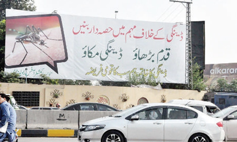 A dengue awareness banner at Kutchery Chowk, Rawalpindi. — Online