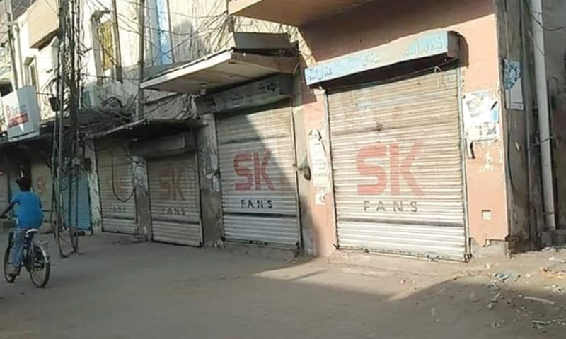 SHOPS in a market of Ghotki are closed in protest against the alleged blasphemous remarks.—Dawn