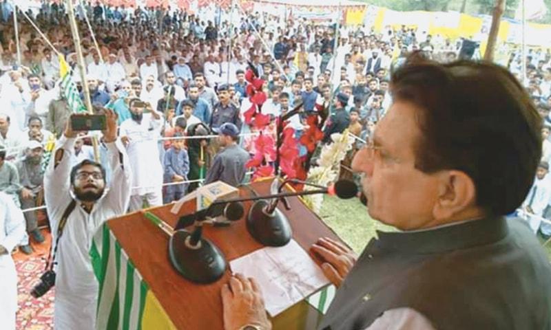 AJK Prime Minister Raja Farooq Haider speaking at a rally at Samahni on Sunday. — Dawn