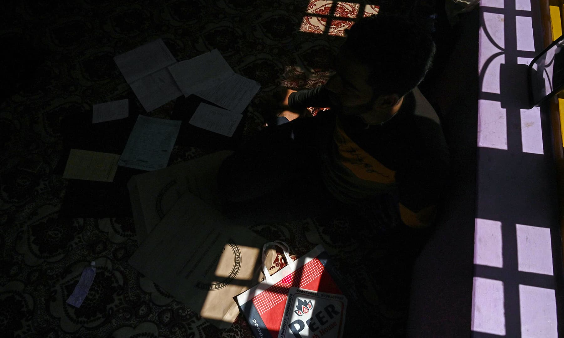 Abid Khan, 26, sits during an interview with *AFP* at Haripora village in Shopian district. — AFP