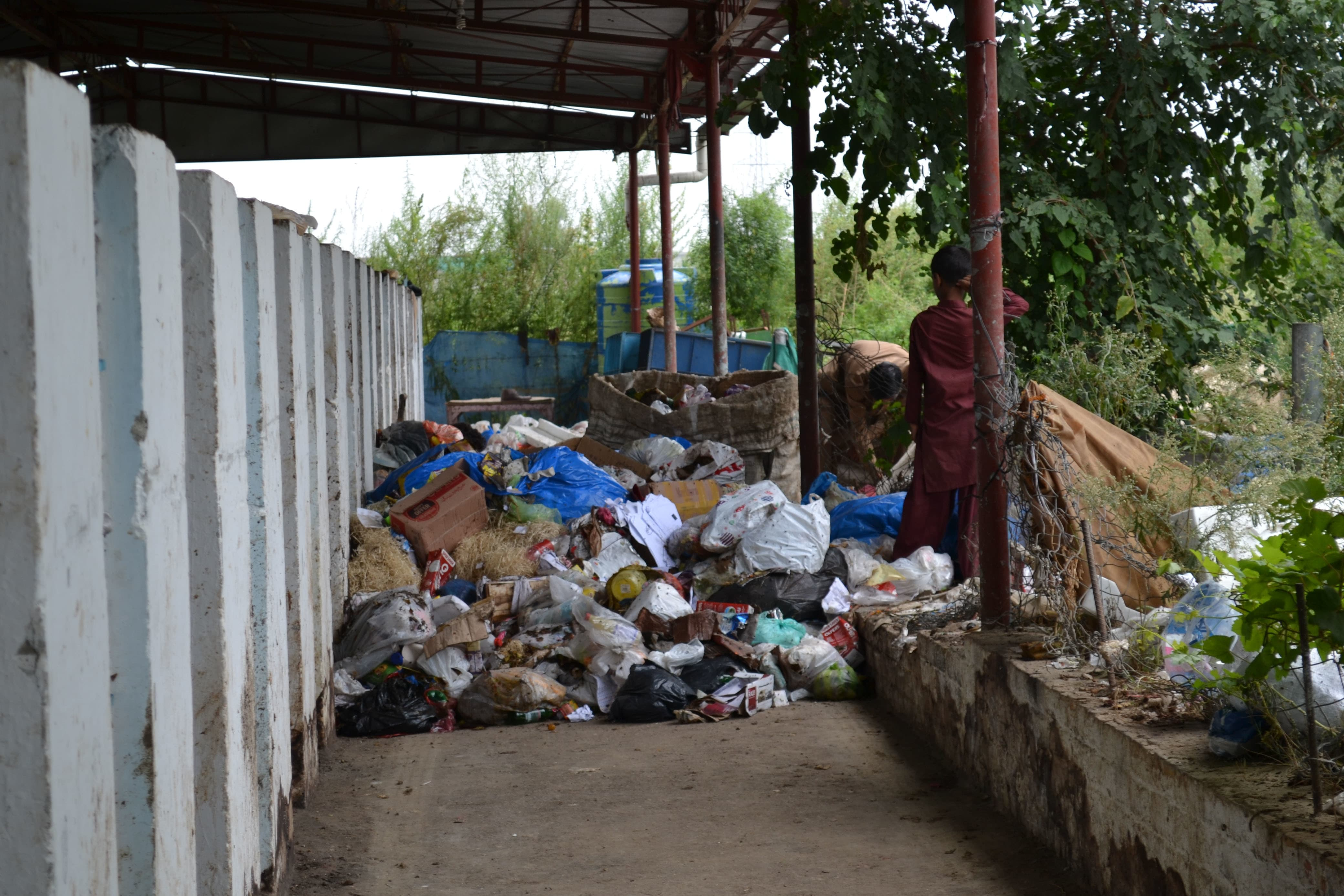 Trash collected from Sector G-15 is being sorted into organic and inorganic waste at the IRRC facility in Islamabad. —*Photo by author*