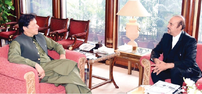 Prime Minister Imran Khan speaks to Dr Babar Awan during the meeting on Monday.—PPI