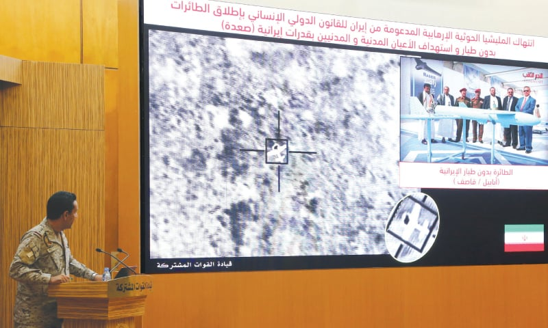 Riyadh: Col Turki Al Malik, spokesperson for the Saudi-led coalition fighting in Yemen, displays on a screen a satellite image of a drone strike. — Reuters