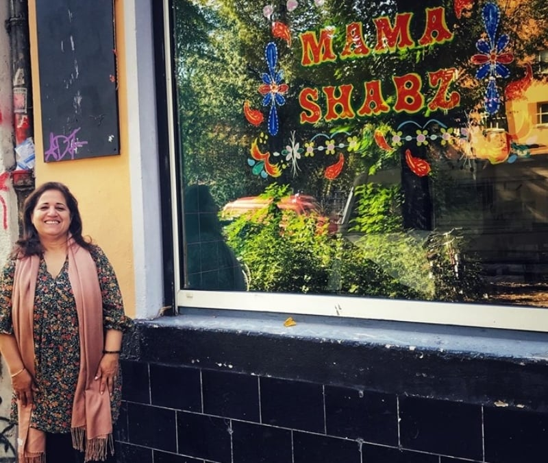 Mama Shabz posing in front of the Mama Shabz cafe, set to open soon.