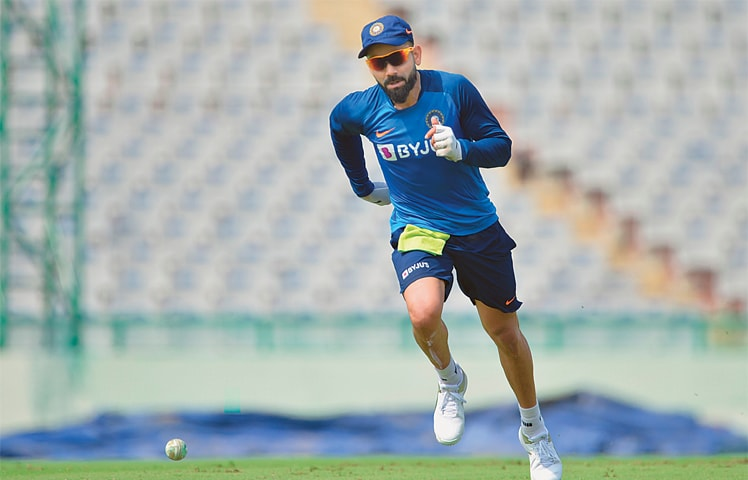 MOHALI: Indian captain Virat Kohli takes part in a training session at the Punjab Cricket Association Stadium on Tuesday, on the eve of the second T20 International against South Africa.—AFP