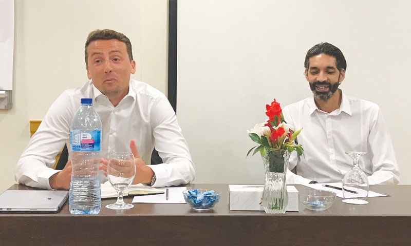 ALEXANDRE Gros (L), the senior governance services manager of FIFA's Member Associations Committee, and Humza Khan, the chairman of the Normalisation Committee for the PFF, gesture during a meeting with selected media on Tuesday.—UW