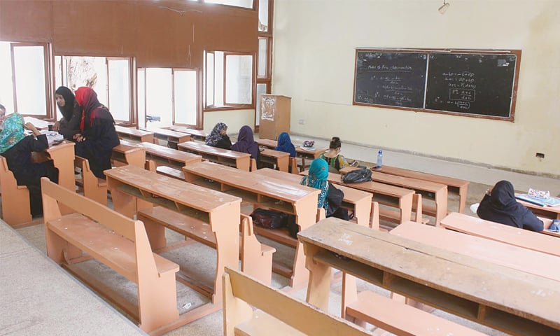 A KARACHI University classroom is largely empty on Tuesday due to the teachers' boycott.—Online