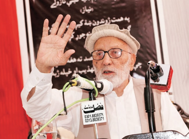A SCHOLAR speaks at a function held in Charsadda on Tuesday to mark the death anniversary of Prof Jahanzeb Niaz. — Dawn