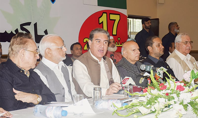 LAHORE: Foreign Minister Shah Mehmood Qureshi speaking at a multiparty Kashmir conference on Tuesday. — White Star