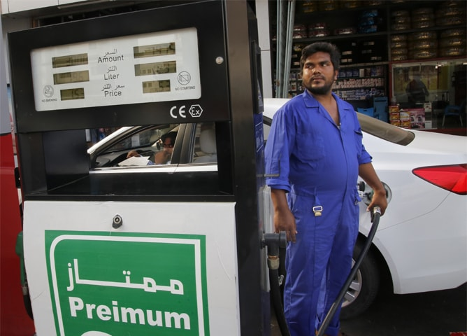JEDDAH: A worker refuels a car at a gas station on Tuesday.— AP