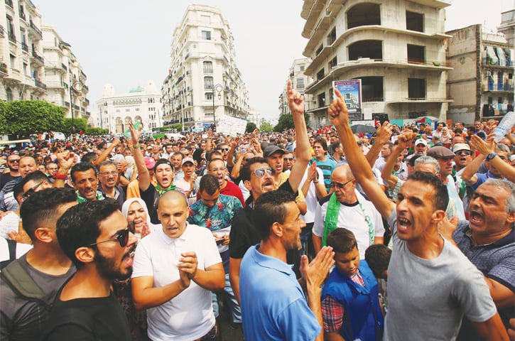 Algiers: Demonstrators shout slogans during a protest rejecting the Algerian government's decision to hold elections in December.—Reuters
