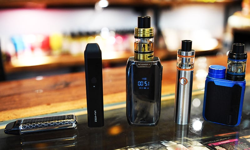 Electronic cigarette devices are pictured on display at a vaping shop in New Delhi on September 18, 2019. — AFP